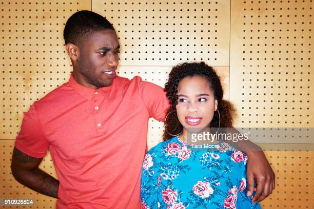 young man and woman making faces at each other