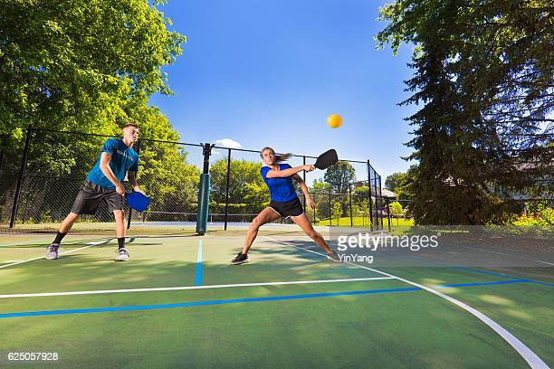Young Man and Woman Pickleball Player Playing Pickleball in Court
