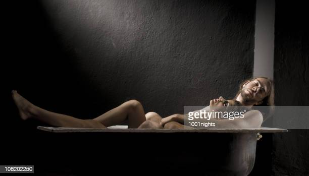 young man and woman relax in bathtub together - couples showering stock pictures, royalty-free photos & images