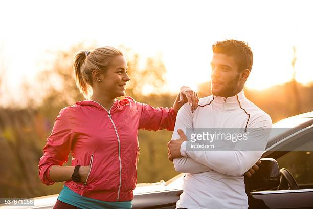 Young man and woman relaxing after exercising