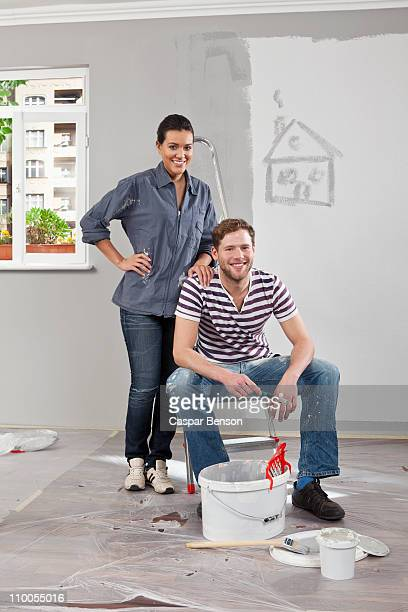A young man and woman renovating an apartment