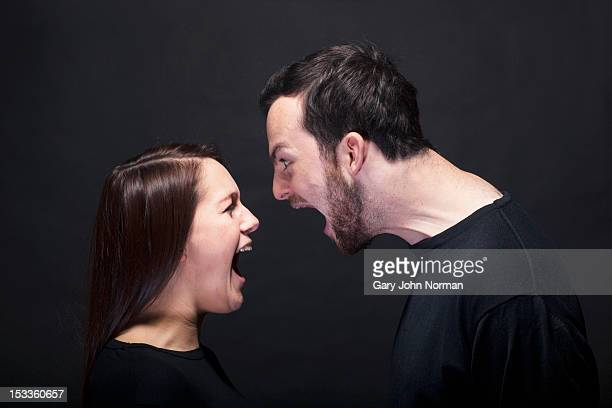 young man and woman shouting at each other - fury stock pictures, royalty-free photos & images