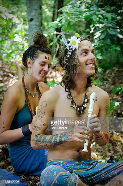 Happy hippie lifestyle in forest with flute