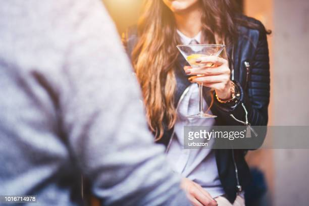 young brunette woman sitting at bar