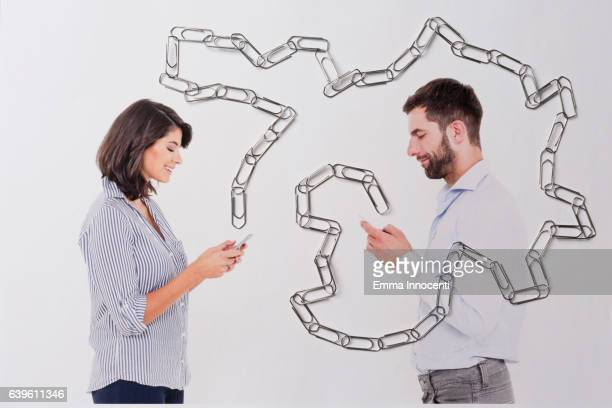 Young man and woman texting
