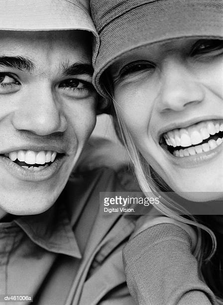 Young man and woman wearing hats
