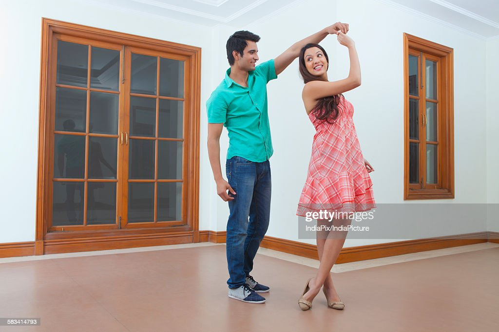 Young man and young woman dancing : Stock Photo
