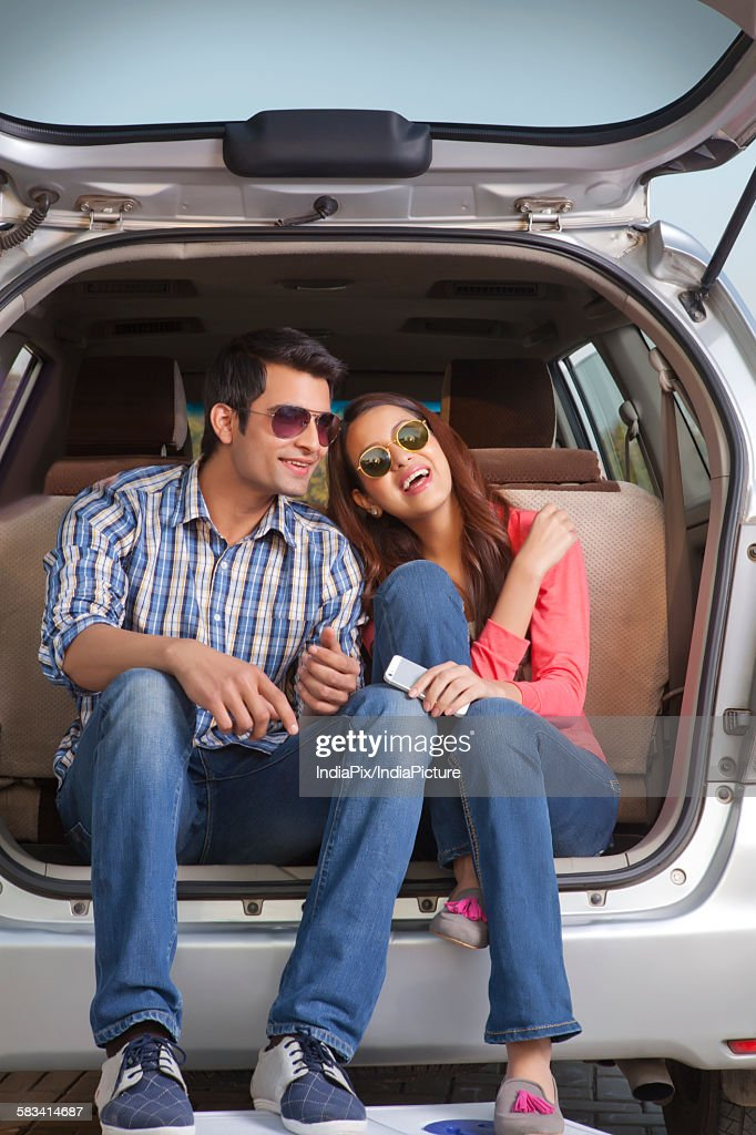 Young man and young woman going for a picnic : Stock Photo