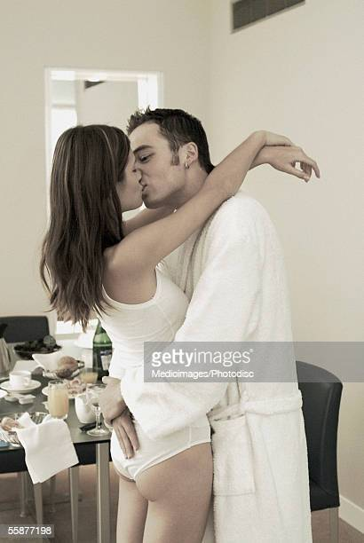 young man and young woman kissing - bacio sulla bocca foto e immagini stock