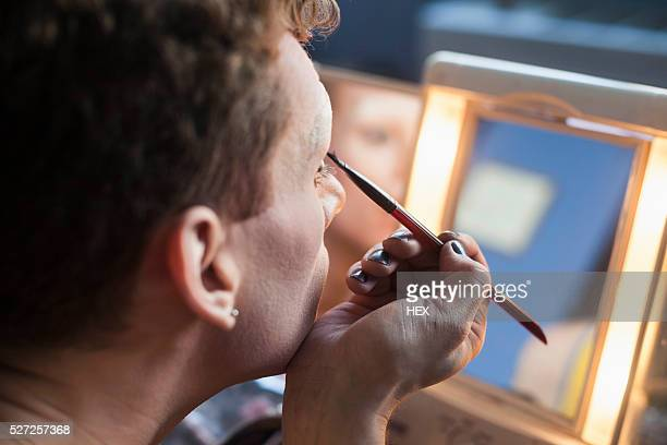young man applying drag makeup - crossdressing stock pictures, royalty-free photos & images