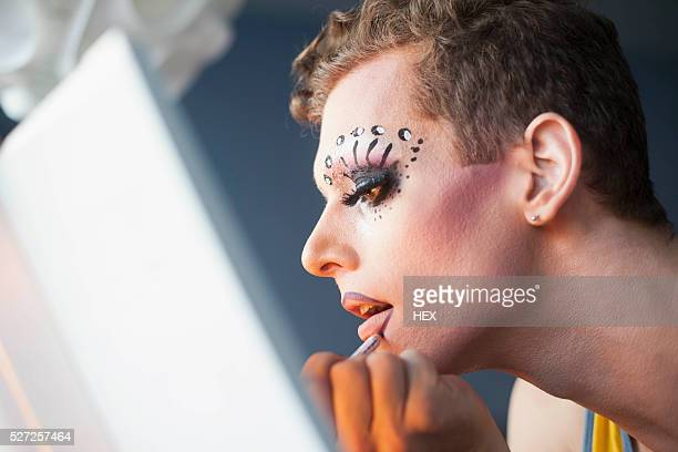young man applying drag makeup - drag queen stock pictures, royalty-free photos & images