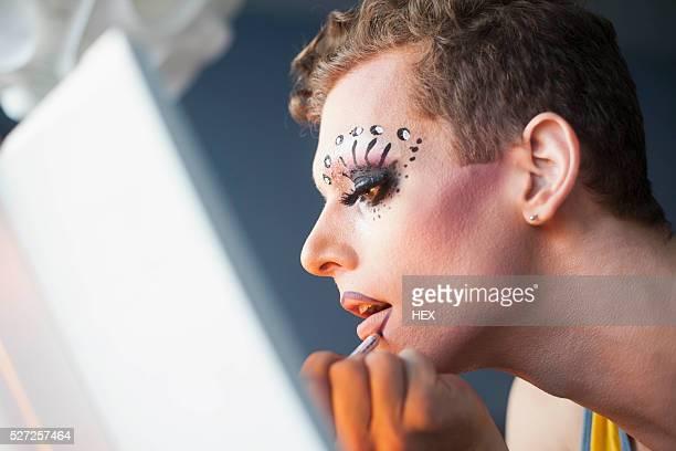 young man applying drag makeup - drag queen foto e immagini stock