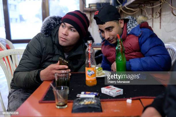 Young man are drinking soda tea or coffee in a cafe on December 27 in Sbeitla Tunisia