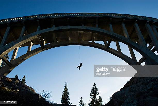 A young man ascends after rappelling off the Donner Pass Bridge in Truckee, California.