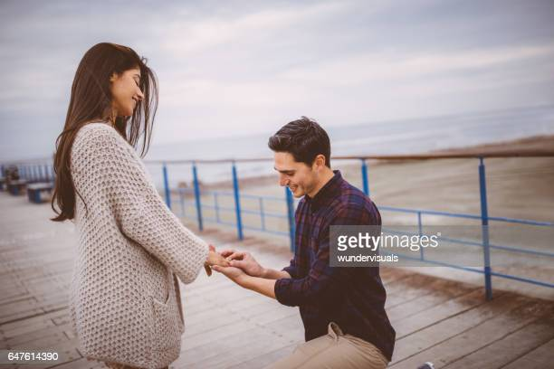 Young man asking his girlfriend to marry him