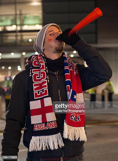 Young man at a England VS Chile match