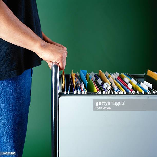 Young Man at a Filing Cabinet
