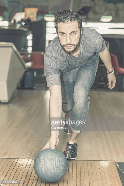 young man (hipster style) at bowling - pjphoto69 stockfoto's en -beelden