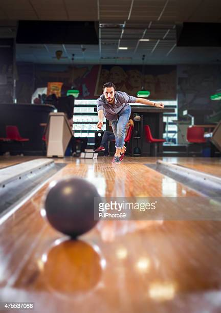 Young man (hipster style) at bowling