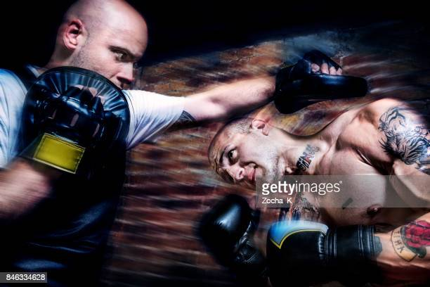 young man at boxing training - ducking stock pictures, royalty-free photos & images