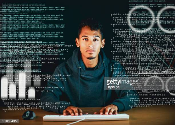 Young man at computer screen full of text