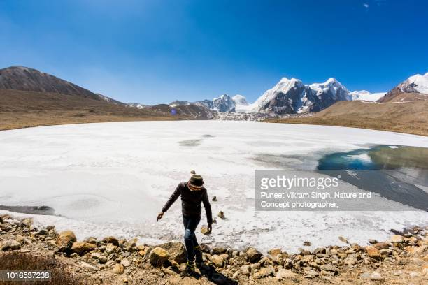 A young man at high altitude lake of Sikkim known as The Gurudongmar Lake