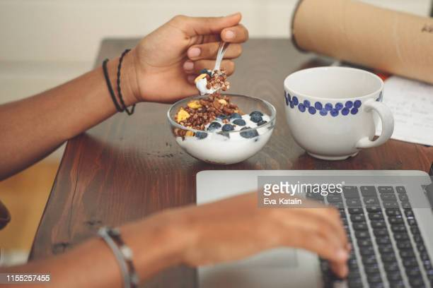 young man at home - snack stock pictures, royalty-free photos & images