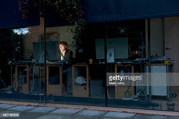 Young man at home working late on computer