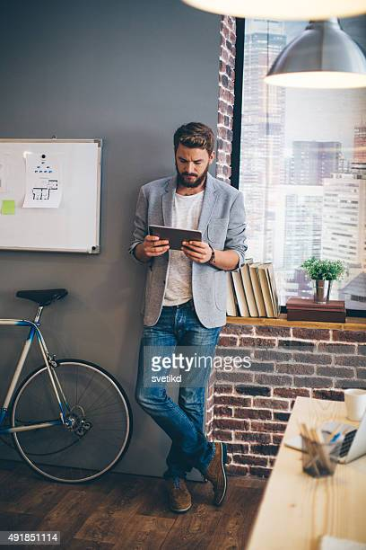Young man at modern office space.