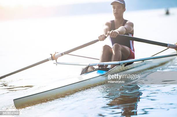 Young man at rowing training