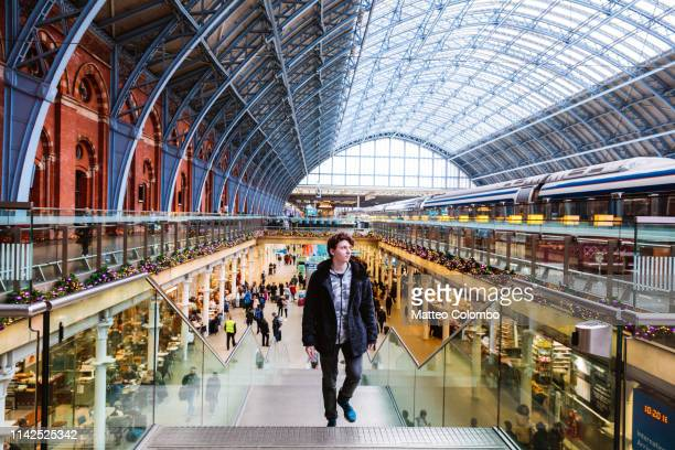 young man at st pancras train station, london, uk - railroad station stock pictures, royalty-free photos & images