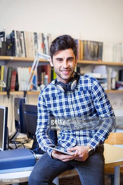 Young man at startup looking happy