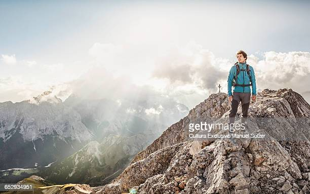 Young man at summit of Mount Hochwanner, Wetterstein Mountains, Bavaria
