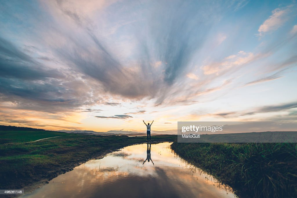 Young man at sunset : Stock Photo