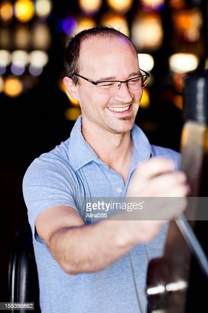 Young man at the slot machine