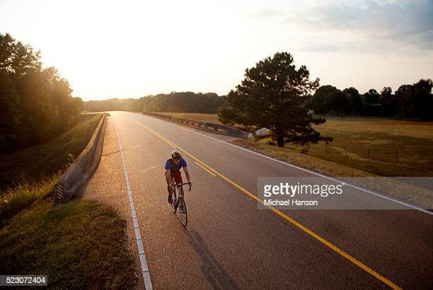 a young man, athletic and fit, rides his road bike on the sunny day, natchez, mississippi, usa - ミシシッピ州 ストックフォトと画像