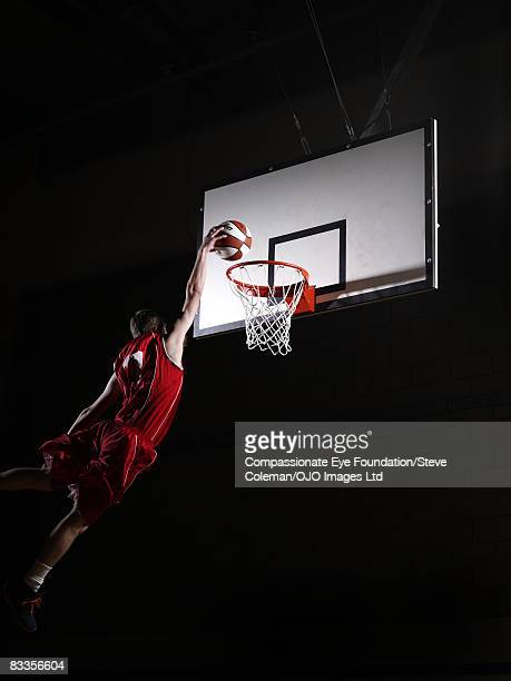 Young man attempting to dunk the basketball