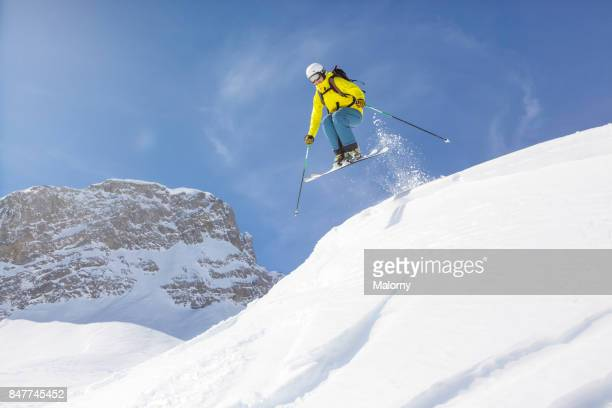 Young man back country skiing in deep snow, powder snow.