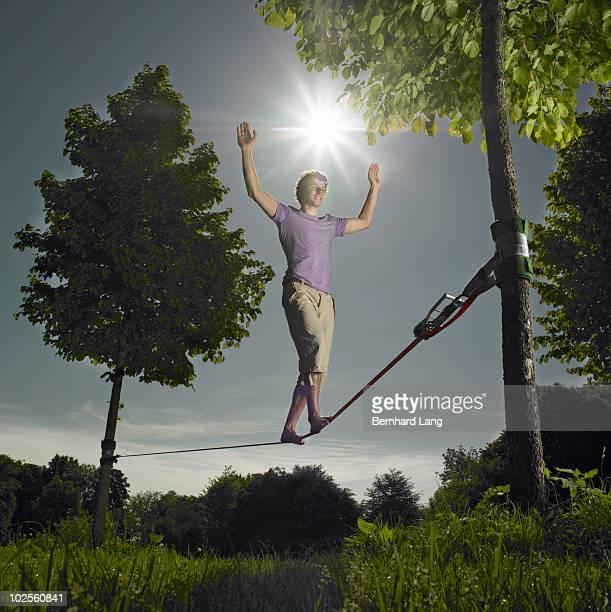 Young man balancing on a slackline