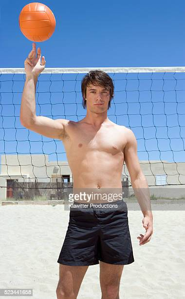 Young Man Balancing Volleyball on His Finger