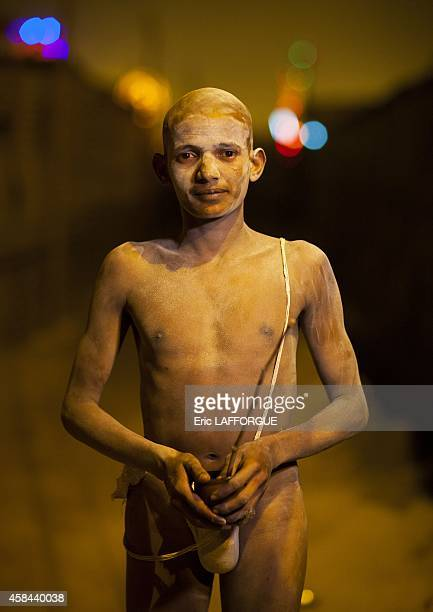 Young man becoming a naga sadhu maha kumbh mela on February 6 2013 in Allahabad India