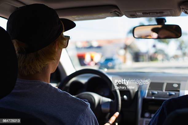 Young man behind wheel of car