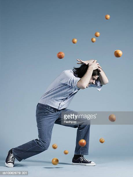 Young man being hit by tomatoes