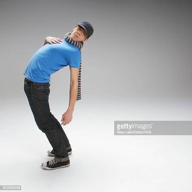 Young man bending backwards