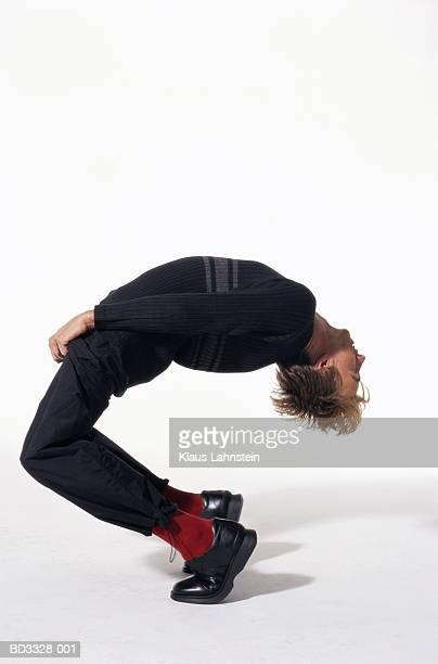 young man bending backwards, profile - bending over backwards stock photos and pictures