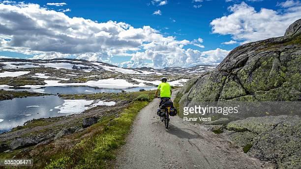Young man bicycles Rallarvegen