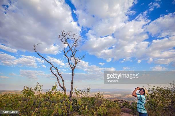 Young man birdwatching in Chapada Brasil