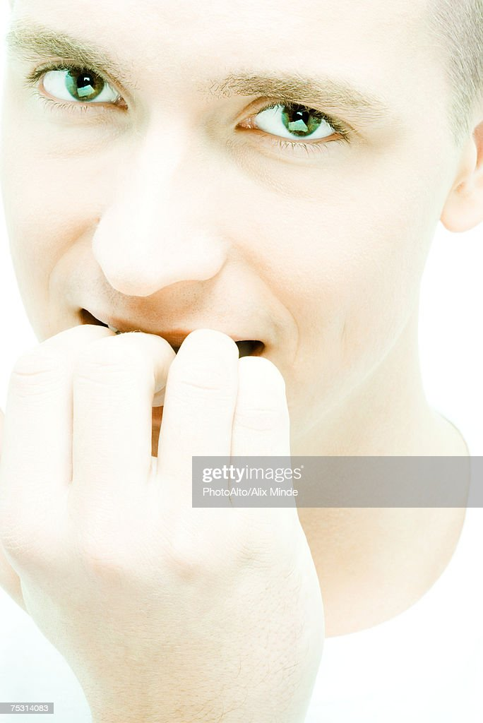 Young Man Biting Nails Closeup Stock Photo | Getty Images