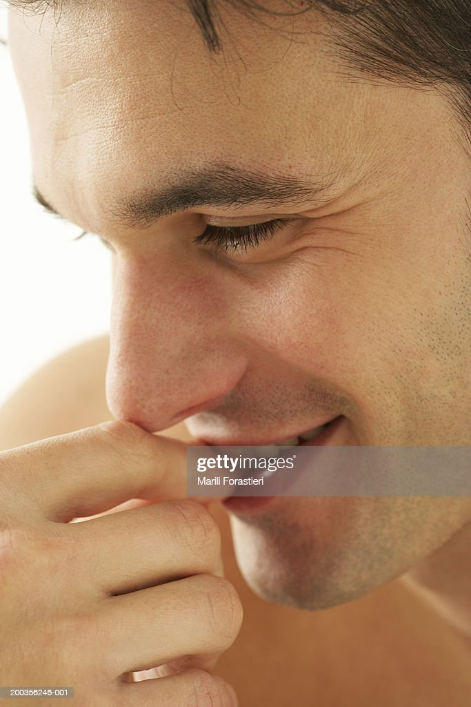 Young Man Biting Nails Smiling Closeup Stock Photo | Getty Images