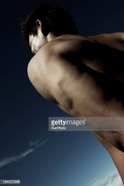 young man body close-up in nature